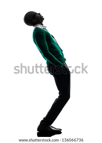 one african  black man standing looking up  surprised in silhouette studio on white background