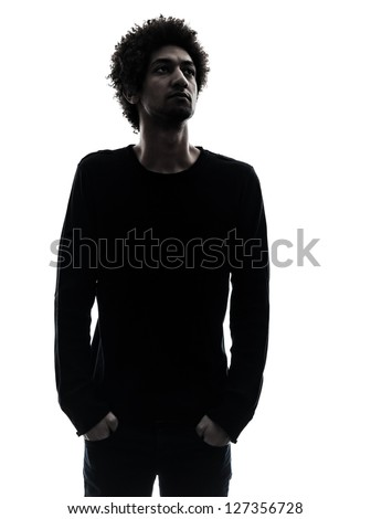 one african handsome young man looking away in silhouette studio isolated on white background