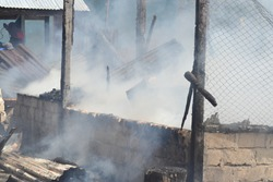 One afternoon in the village of Kornasoren, a community-owned house was burned down by the community, working together to try to extinguish the fire