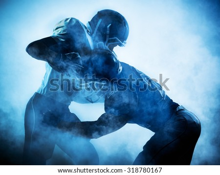 one american football players portrait in silhouette shadow on white background