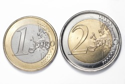 One and two euros coins on white background