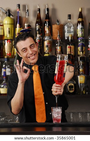 One bartender pouring a drink. Barman preparing cocktail.