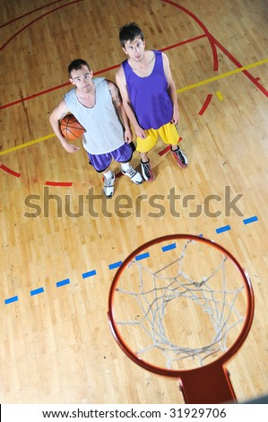 one basket ball game player standing in sport gym with ball