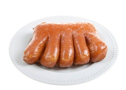 One bear claw donut on a fancy off white porcelain plate, isolated on white. A yeast donut shaped like a bear claw. filled with apple fruit and covered in sugar glaze.