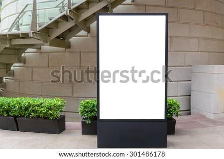 One big vertical / portrait orientation blank billboard in park