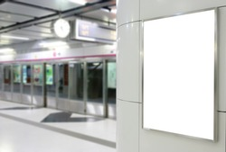 One big vertical / portrait orientation blank billboard on modern white wall with platform background