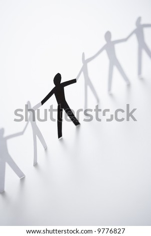 black and white pictures of people holding hands. stock photo : One lack cutout