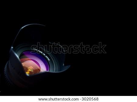 One black lens on the black bacjground