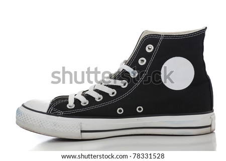 One black retro high top sneaker on a white background