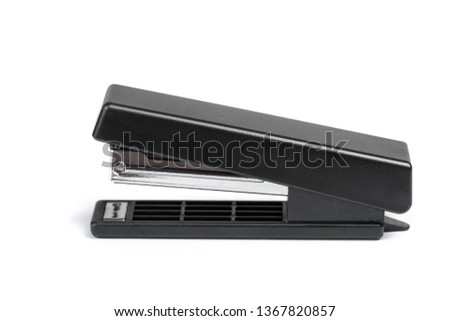 One black stapler isolated on white background