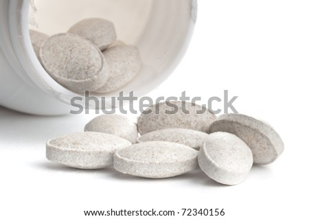 One box of grey pills over white background