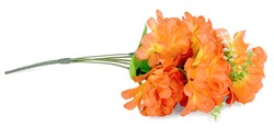 One branch of artificial flowers rose peony is made of a fabric orange flowers vertically. Image closeup isolated on white background.