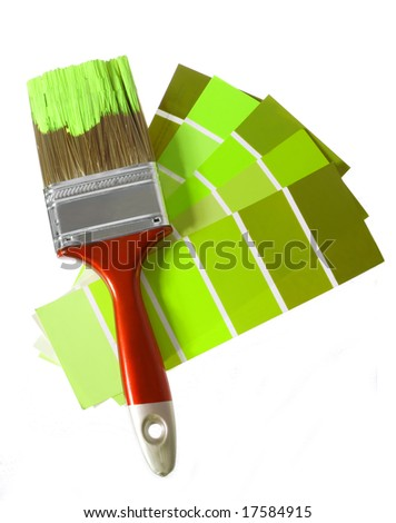one brush and palette at green tone - stock photo