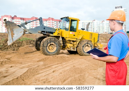 One builder worker with clipboard inspecting earthmoving works at construction site