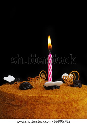 One candle with fire on the part of torte.