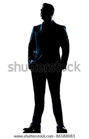 one caucasian  business man  handsome full suit standing full length serious silhouette in studio isolated white background