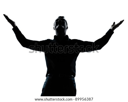 one caucasian business man happy arms outstretched portrait silhouette in studio isolated on white background