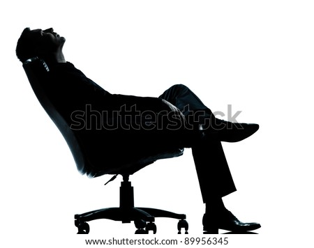 one caucasian business man relaxing  sitting in armchair silhouette Full length in studio isolated on white background