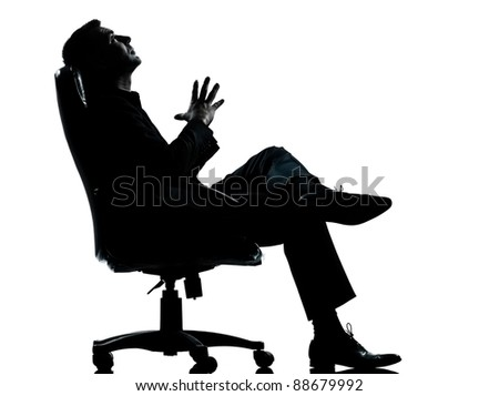 one caucasian business man relaxing thinking sitting in armchair silhouette Full length in studio isolated on white background