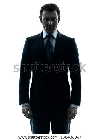 one caucasian business man serious looking at camera  in silhouette studio isolated on white background #138436067