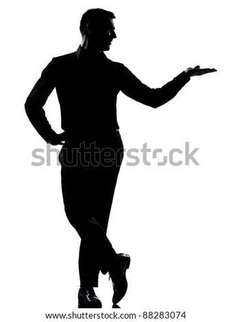 one caucasian business man silhouette standing hand open  Full length in studio isolated on white background