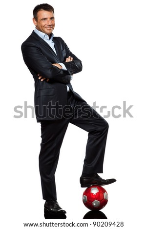one caucasian business man standing arms crossed foot on soccer ball in studio isolated on white background