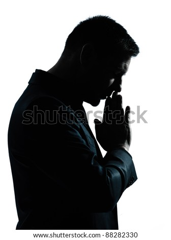 one caucasian business man thinking praying  portrait silhouette in studio isolated on white background - stock photo