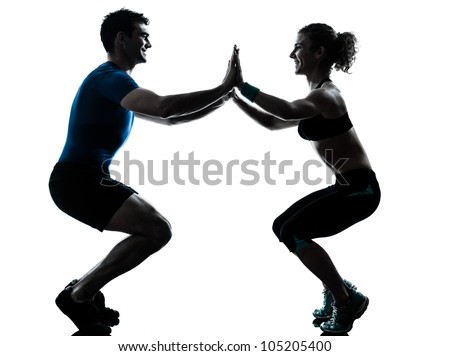 one caucasian couple man woman personal trainer coach exercising squats silhouette studio isolated on white background