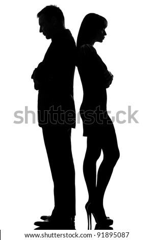 one caucasian couple standing back to back dispute conflict  man and woman sad in studio silhouette isolated on white background