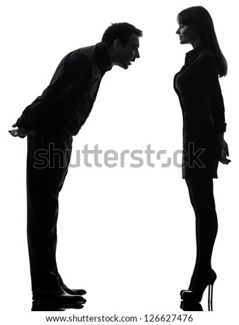 one caucasian couple woman seducing man in silhouette studio isolated on white background