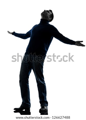 one caucasian happy man looking up full length in silhouette studio isolated on white background
