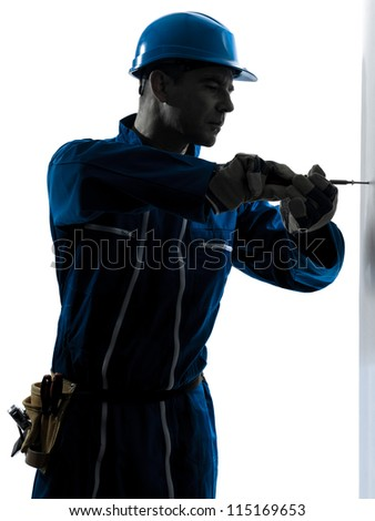 one caucasian man construction worker screwdriving silhouette in studio on white background