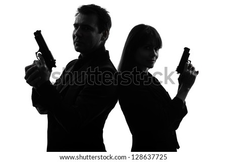 one caucasian man detective secret agent criminal  with gun  in silhouette studio isolated on white background
