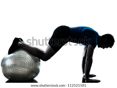 Workout fitness ball in silhouette studio isolated on white background