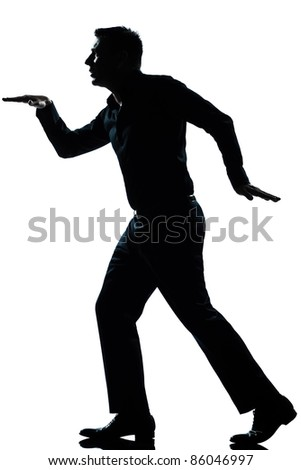 one caucasian man funny egyptian style walking  full length silhouette in studio isolated white background