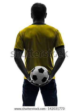 one caucasian man holding soccer football silhouette rear view back  in silhouette on white background