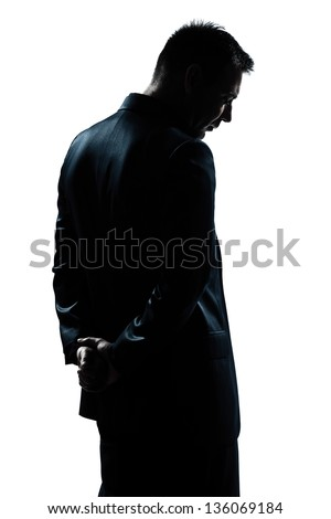 one caucasian man portrait silhouette backside sad despair lonely in studio isolated white background #136069184