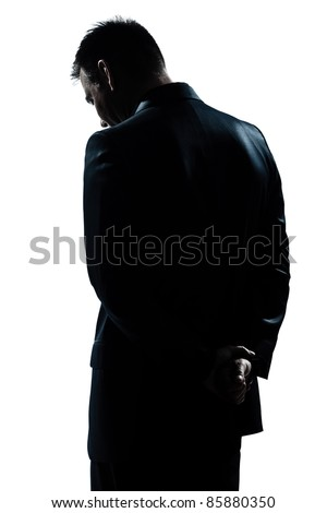 one caucasian man portrait silhouette backside sad despair lonely in studio isolated white background
