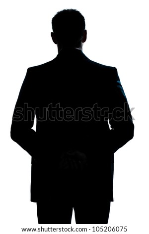 one caucasian man portrait silhouette backside standing hands behind back in studio isolated white background