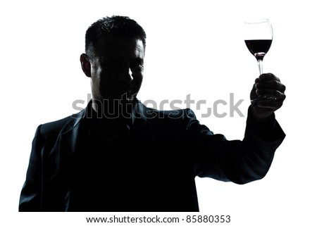one caucasian man portrait silhouette rising up toasting his glass of red wine in studio isolated white background