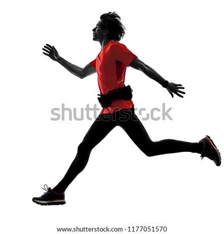 one caucasian man pratcticing runner running jogger jogging in studio silhouette isolated on white background #1177051570