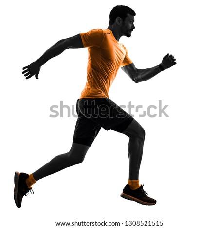 one caucasian man runner running jogging jogger silhouette isolated on white background #1308521515