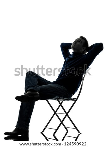 one caucasian man sitting resting looking up  full length in silhouette studio isolated on white background