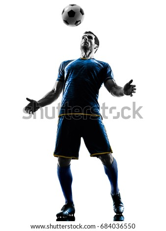 one caucasian soccer player man playing in silhouette isolated on white background