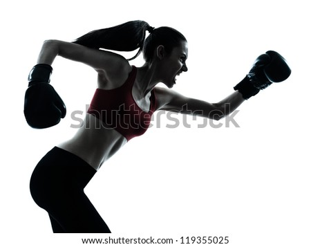 one caucasian woman boxing exercising in silhouette studio  isolated on white background