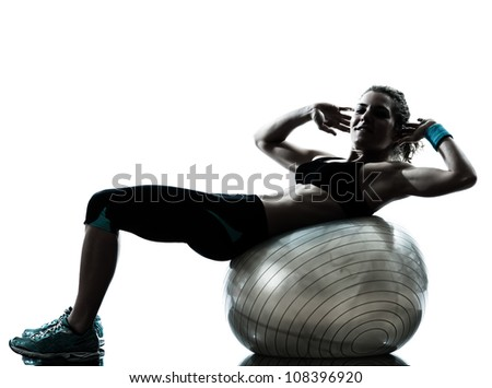 one caucasian woman exercising fitness ball workout posture in silhouette studio isolated on white background