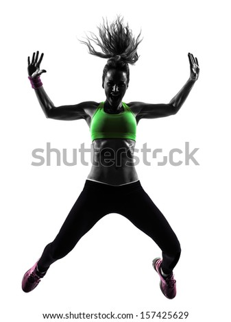 one caucasian woman exercising fitness dancing jumping in silhouette  on white background