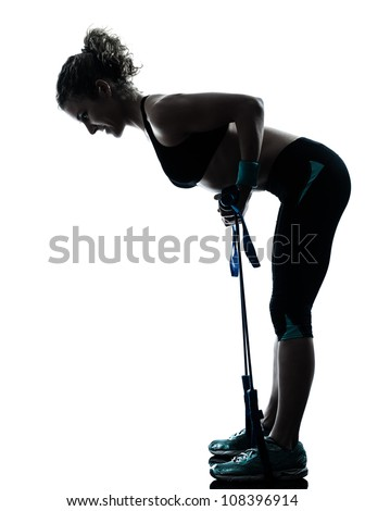 one caucasian woman exercising gymstick  fitness workout posture in silhouette studio isolated on white background