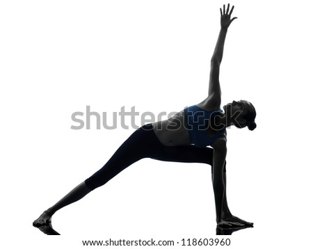 one caucasian woman exercising stretching triangle pose yoga in silhouette studio isolated on white background