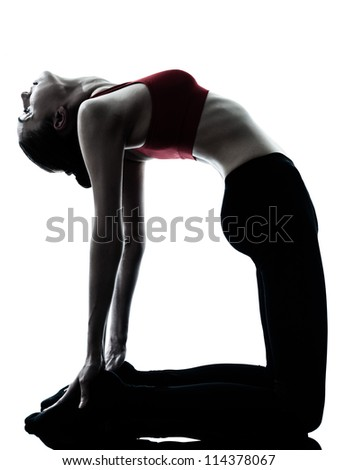one caucasian woman exercising yoga camel pose in silhouette studio isolated on white background